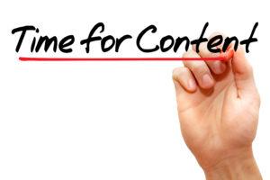 Slika ruke koje pise Time for Content
